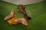 A Two-Year-Old Malnourished Boy Sleeps Photographic Print by Akhtar Soomro