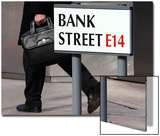 A Worker Passes a Sign for Bank Street in the Canary Wharf Financial District in London Print by Luke MacGregor