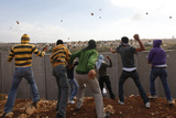 Demonstrators Throw Stones at Israeli Troops During a Protest in Nilin Photographic Print by Yannis Behrakis
