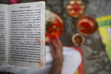 A Hindu Priest Reads a Holy Book with Prayers Written Photographic Print by Navesh Chitrakar