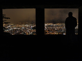 A Man Looks Out at the View of Tegucigalpa at Night Photographic Print by Edgard Garrido