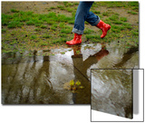 A Woman Wearing Rubber Boots Walks Near a Puddle in Boston, Massachusetts Prints by Brian Snyder