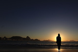 A Woman Wears a Sweatshirt after Swimming at Sunrise on Copacabana Beach in Rio De Janeiro Photographic Print by Ricardo Moraes