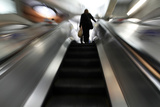 A Passenger Uses an Escalator in a London Underground Station Photographic Print by Andrew Winning