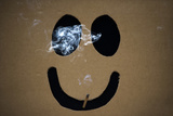 Smoking a Marijuana Joint Inside a Box with a Happy Face Cut Out before the Global Marijuana March Photographic Print by Mark Blinch