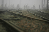 Commuters Walk across Railway Tracks Amid Heavy Fog in New Delhi Photographic Print by Adnan1 Abidi