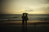 A Couple Watch as the Sun Sets Behind the Indian Ocean Along the Galle Face Green in Colombo Photographic Print by Tim Chong