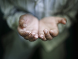 A Hand of a Muslim Boy Offering Prayer Is Pictured During the Holy Fasting Month of Ramadan Photographic Print by Navesh Chitrakar
