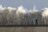 A Man Films Storm Waves Pounding the Seafront in Lowestoft, Suffolk, Eastern England Photographic Print by Stringer UK