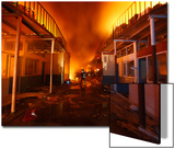 Firefighter Is Pictured Inside Burning Electronics Warehouse Belonging to Chaudhary Group Prints by Navesh Chitrakar