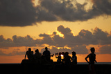 People Sit on Havana's Seafront Boulevard -El Malecon- During Sunset Photographic Print by Desmond Boylan