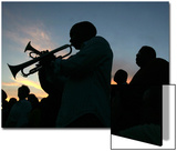 New Orleans Residents Play Trumpet During a Candlelight Ceremony Posters by Carlos Barria