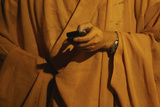 A Monk Checks His Phone Inside a Temple in Shanghai Photographic Print by Aly Song