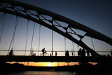 People Walk and Bike Along on the Humber River Pedestrian Bridge in Toronto Photographic Print by Mark Blinch