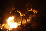 Firefighters Try to Extinguish a Fire with Branches in a Forest at Barranco Blanco in Coin Photographic Print by Jon Nazca