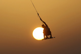 An Israeli Man Kite Surfs in the Mediterranean Sea at the Southern Israeli City of Ashkelon Reproduction photographique par Amir Cohen