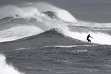 A Surfer Rides a Large Wave Off the Coast of Ocean Beach, California During a Winter Storm Photographic Print by Mike Blake