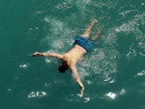 An Afghan Man Swims in a Public Swimming Pool in Kabul Photographic Print by Omar Sobhani