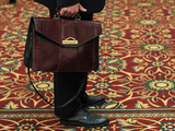 A Man Holds His Briefcase While Waiting in Line During a Job Fair in Melville, New York Photographic Print by Shannon Stapleton