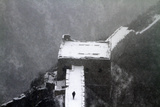 A Man Walks on the Great Wall of China During a Heavy Snowfall on the Outskirts of Beijing Photographic Print by Jason Lee