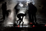 A Man Gets Out of Icy Watesr During an Orthodox Epiphany Celebration in the Ancient Town of Suzdal Photographic Print by Denis Sinyakov