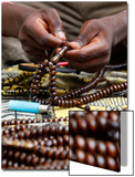 A Man Makes Muslim Rosaries in Treichville in Abidjan Art by Thierry Gouegnon