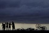Youths Stand on Havana's Seafront Boulevard El Malecon Photographic Print by Enrique de la Osa