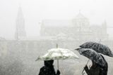 People Stand with Umbrellas in the Snow, in Cordoba Photographic Print by Javier Barbancho