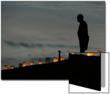 A New Orleans Resident Stands During a Candlelight Ceremony Prints by Carlos Barria