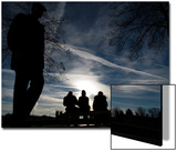 People are Silhouetted as They Relax on a Bench During a Sunny Autumn Day in Berlin Prints by Pawel Kopczynski