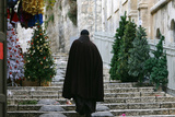 Priest Walks Past Christmas Trees in Alley Near Jaffa Gate in Jerusalem Photographic Print by Ronen Zvulun