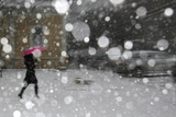 A Woman Shields Herself under an Umbrella as She Walks During a Heavy Snowfall Photographic Print by Stoyan Nenov