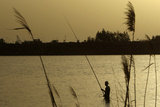 A Libyan Man Fishes in the Sea of Benghazi Photographic Print by Mohammed Salem