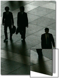 Businessmen Walk Through a Public Square in Downtown Tokyo Prints by Michael Caronna