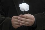 A Man Holds a Paper Chrysanthemum Flower While He Mourns Photographic Print by China Daily