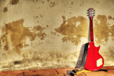 Electric Guitar Leaned on a Rustic Wall in Hdr Fotoprint van Gabriele Maltinti