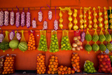 Fresh Fruit at Colorful Fruit Stand Photographic Print by  EvanTravels