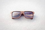 Double Exposure of Wooden Sunglasses and Desert Road Photographic Print by  xcid