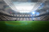 Large Football Stadium with Lights Photographic Print by  WavebreakMediaMicro