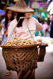 Woman Carrying Peanut Baskets - Golden Triangle, Thailand Photographic Print by  EvanTravels