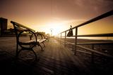 Bench on Coney Island Boardwalk Photographic Print by  EvanTravels