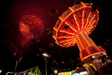 Carnival Swing Ride under Fireworks Photographic Print by  EvanTravels