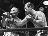 Rocky Marciano Landing a Punch on Jersey Joe Walcott, Sept. 23, 1952 Metal Print