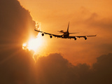 Jumbo Jet Banking Into Sunset Metal Print by Peter Walton