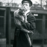 Keeper, Leslie Martin Flewin, Holding a Kinkajou at London Zoo, February 1913 Photographic Print by Frederick William Bond