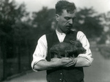 Keeper Harry Warwick Cradles a Baby Warthog in His Arms at London Zoo, August 1922 Photographic Print by Frederick William Bond