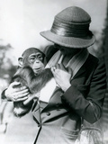 A Lady Holds a Young Chimpanzee at London Zoo, June 1922 Photographic Print by Frederick William Bond