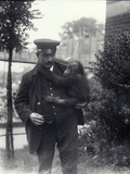 Keeper Z. Rodwell Holding Young Orangutan at London Zoo, October 1913 Photographic Print by Frederick William Bond