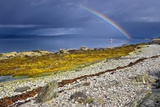 Rainbow Above Rocky Beach and Small Boat Photographic Print