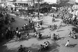 Chaos, Cycles and Rickshaws at City Road Intersection, Varanasi, Uttar Pradesh, India, 1982 Photographic Print